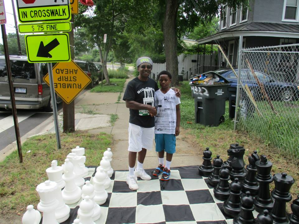 Eugene Brown with Friend Playing Chess