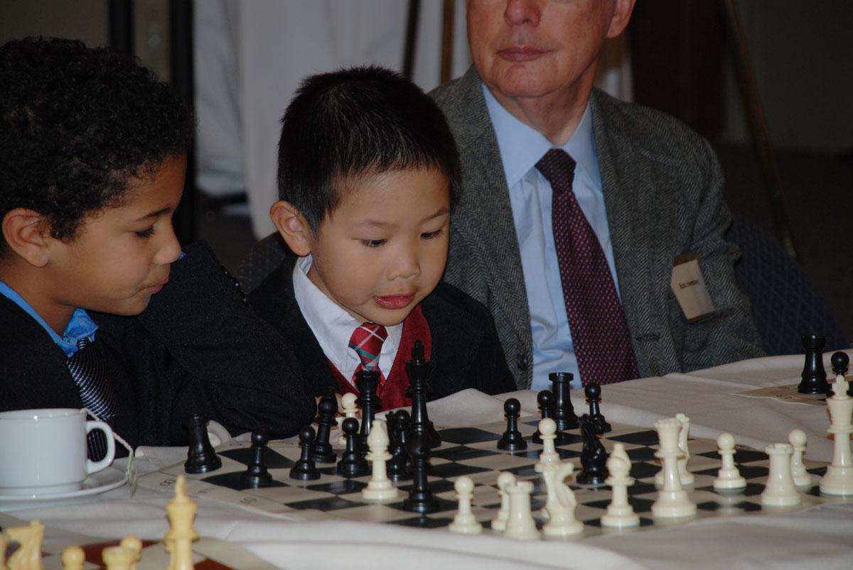 Boy playing chess at the Big Chair Chess Club